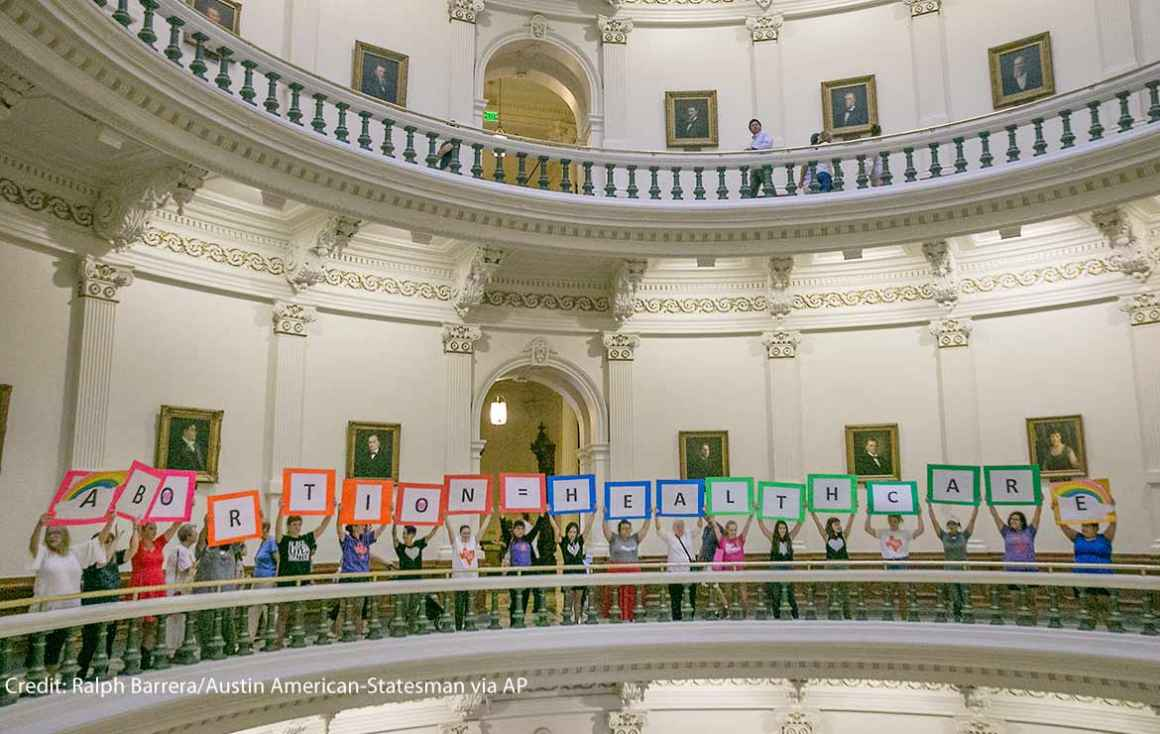 Photo: Representatives of the Trust, Respect, Access Coalition, holding multicolored signs spelling out ABORTION=HEALTHCARE, gathered in the Texas Capitol Rotunda Thursday afternoon July 27, 2017 to voice their opposition to abortion legislation being...