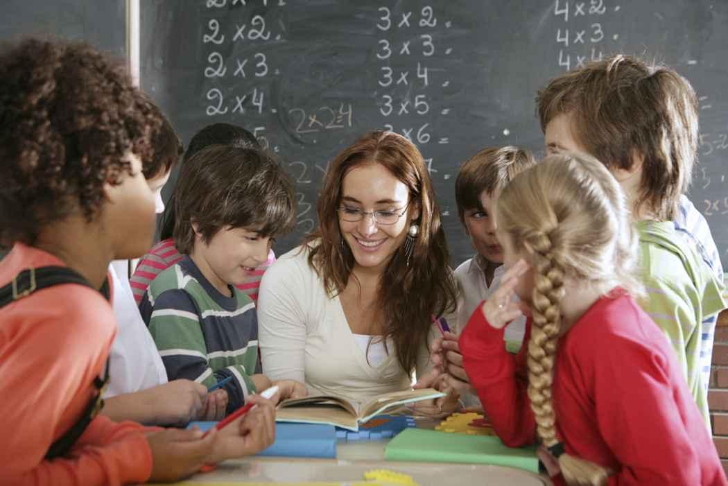 Group of kids around teacher