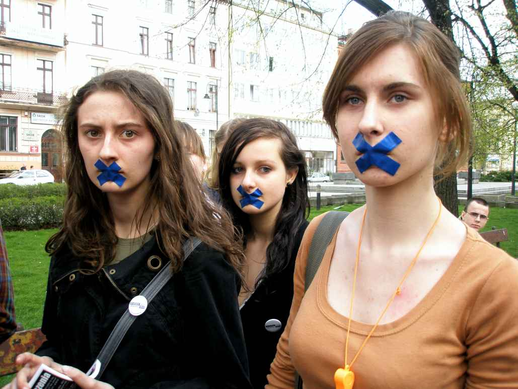 Students with tape on their mouths for day of silence