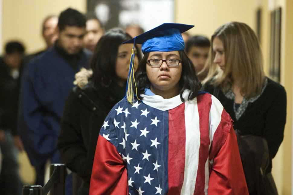 DREAMER student in American flag cap and gown
