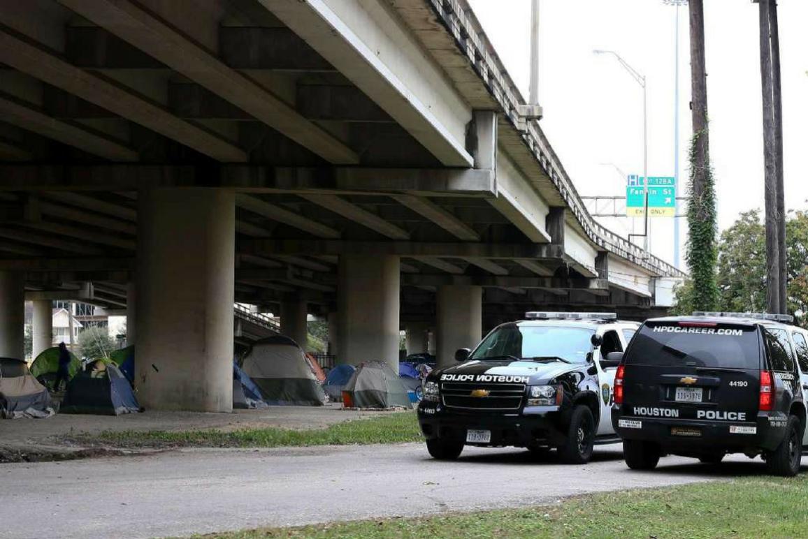 Houston police outside of homeless encampment.