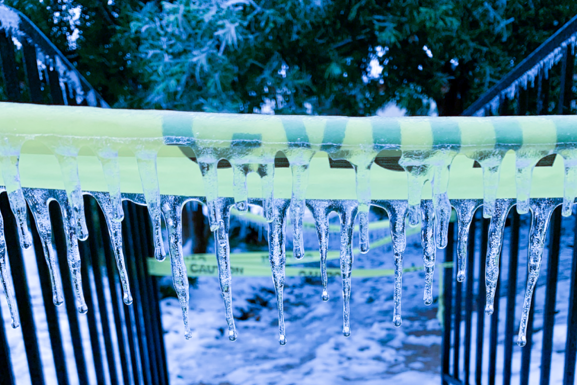 Image of yellow caution tape covered in icicles