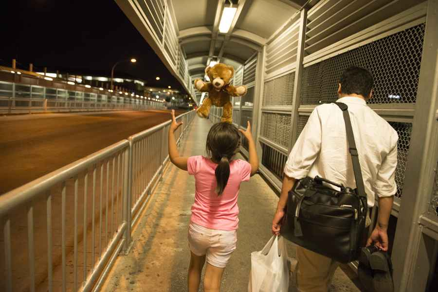 Giselle_Zarco_and_her_father's_attorney,_John_Antia,_walk_across_the_bridge_into_the_United_States_two_days_before_the_big_crossing..jpg