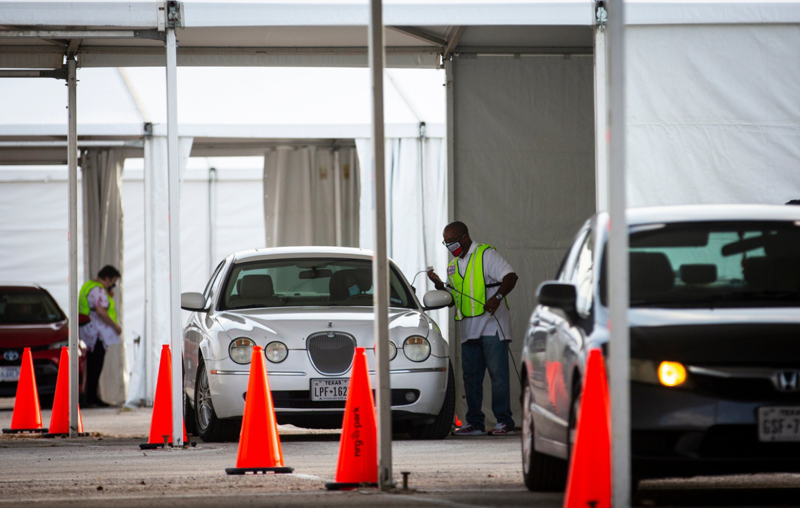 Cars line up during the pandemic to vote by drive-thru