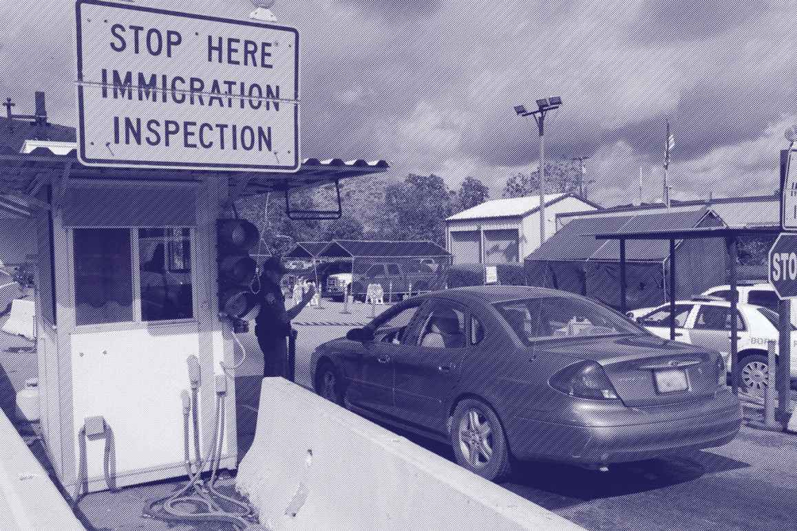 A care arrives at an immigration checkpoint within the 100-mile zone