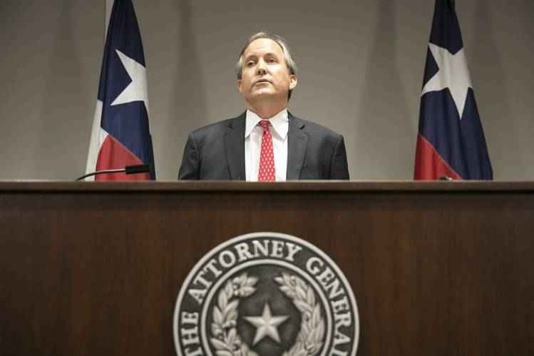 Texas attorney general Paxton at podium