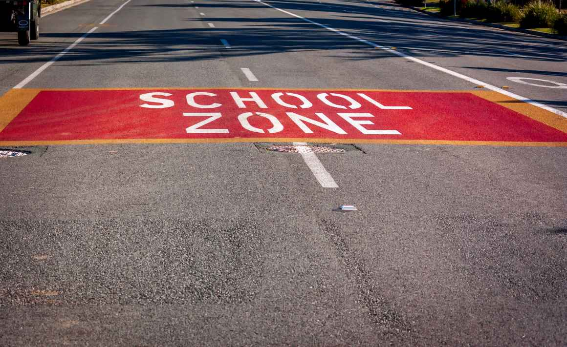School zone painted on the road