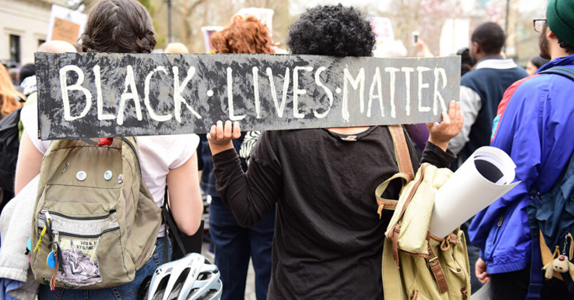 Protester carrying a Black Lives Matter sign