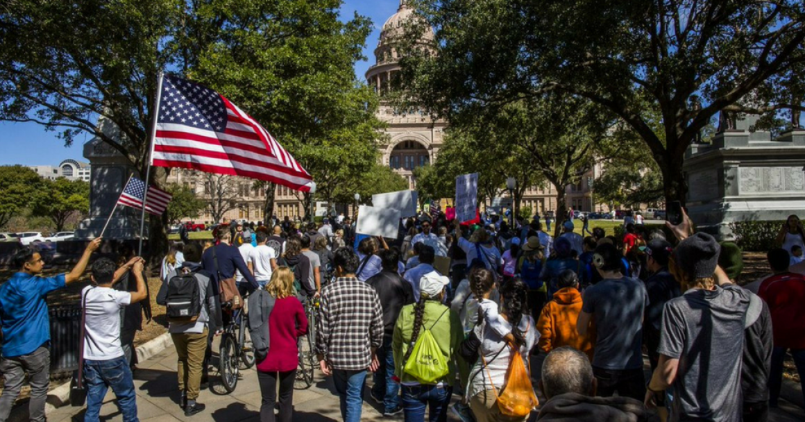students rally against SB4 at the Texas capitol